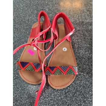 african themed red sandals...